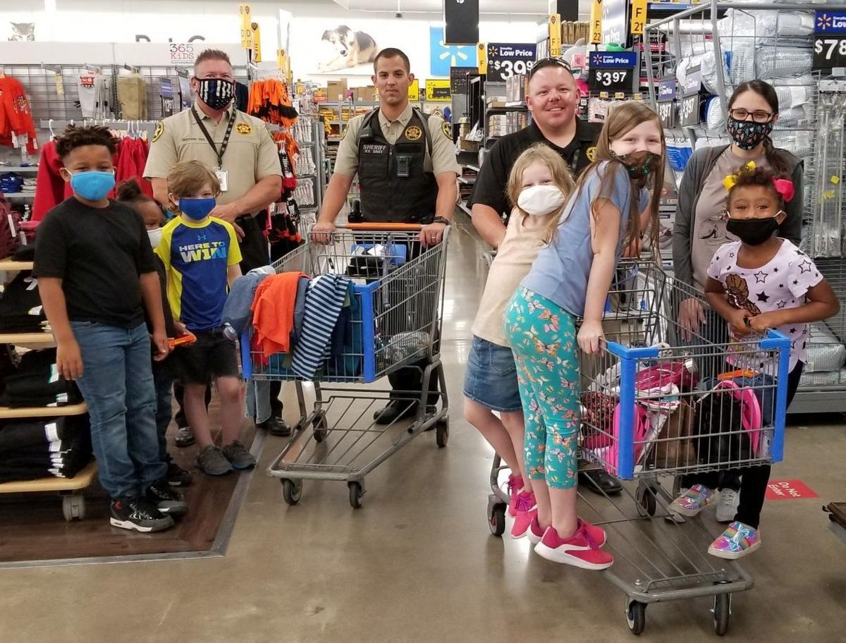Wagoner children, law enforcement officers shop for back to school